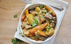 Seitan, carrots, potatoes, and peas are served in a thick, rich gravy.