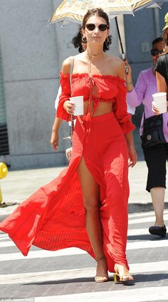 Red hot:Emily Ratajkowski ensured she was the centre of attention as she stopped off at G...