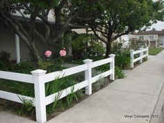 Tasteful 2 rail front yard fence.
