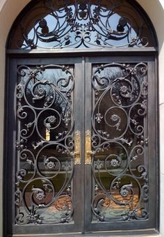 Wrought iron doors are indeed a style from the past. With creativity, you can make your house look more sophisticated with the wrought iron front doors. Double Door Design, Front Door Design, Cool Doors, Unique Doors, Iron Front Door, Front Doors, Front Entry, Wrought Iron Doors, Metal Doors