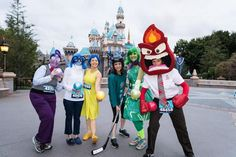 Fun Inside Out costume ideas for Fear, Sadness, Joy, Hockey-playing Riley, Disgust and Anger from Disney Pixar Inside Out. These Inside Out costumes double as running costumes from RunDisney at Disneyland.