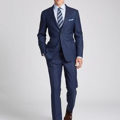 The navy suit served straight up with a crisp solid shirt, striped tie and…