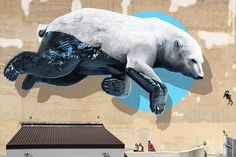 Huge Polar Bear Mural in Turin Black Machine is a project born from a collaboration between Teatro Colosseo Gallery in Turin Italy and Swiss artist Nevercrew. For this project the artist painted an impressive giant white bear on the theater facade. 3d Street Art, Murals Street Art, Amazing Street Art, Street Art Graffiti, Street Artists, Graffiti Designs, Turin Italy, Mural Painting, Wall Paintings