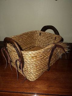 Rope Basket With Worn Horseshoes