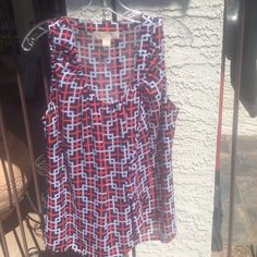 Michael Kors super cute mod crêpe flowy  top EUC Like new this flowing light longish petite top is super cool and modern classic. Rarely worn it is in like new condition. There is a shadow in the picture from the tree that was next to it, no defects. Lower prices with a bundle Michael Kors Tops