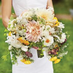 Unique crescent shape bouquet but in all whites, browns and greens with gold accents.