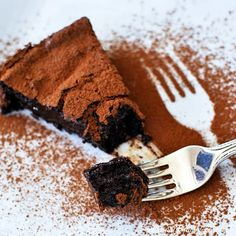 """Ottolenghi's Chocolate Fudge Cake - """"Like a cross between a cake and a baked chocolate mousse or soufflé. One layer is firmer, cake-ier and the other is gooey like brownie batter."""""""