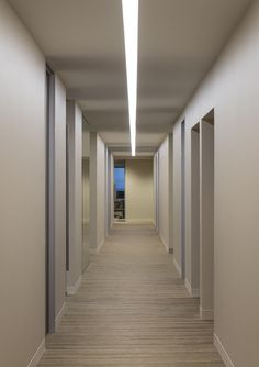 Corridors at HUB International are sleek, modern, and grounded with the Plank collection from Milliken. Designed by by Furstenwerth + Bagley Design. Photo by Danny Piassick#floorcovering #flooring #carpet #interiordesign #commercialdesign #hallway #corporatoffice