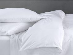Coyuchi 220 Percale Organic Cotton Queen Sheets in White; Ethically sourced and made in India.