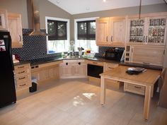 Space under the corner sink and cabinets accommodates a for Wheelchair accessible kitchen ideas