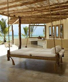 Love the idea of having a swinging bed on the patio to enjoy quiet moments. Would be very easy to make... I so want one of these ... right next to the hot tub. would be cool....