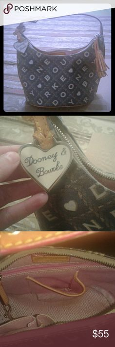 Dooney and Bourke purse I'm good condition somewhat stained in the inside but not bad at all!!! Dooney & Bourke Bags