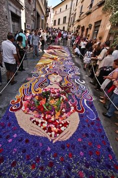 Spello Infiorate, an annual festival at Spello, a hill town in Umbria. After weeks of planning and preparing millions of flowers petals, teams prepare a huge series of flower collages on the streets of the town.