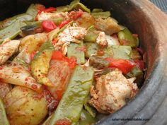 Delicious Tavuk Guvec, Turkish chicken and vegetable stew in earthenware pot--leave potatoes out for lower-carb