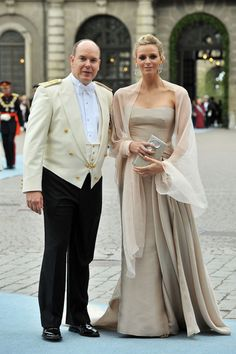 Prince Albert and Princess Charlene of Monaco looking chic at the wedding of Sweden's crown princess.