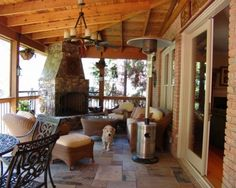 Covered deck with a fireplace; this is what we need for our back yard.