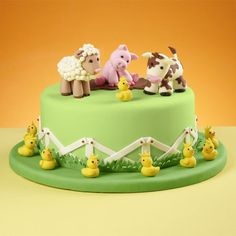 Celebrate farm-animal friends with this country-style cake, perfect for any special birthday. Topped with a lamb, pig, cow and chicks—made with our Shape-N-Amaze edible decorating dough—this cake is covered in a fenced-in green fondant pasture.