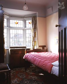 "John Lennon's childhood bedroom at ""Mendips."" (Photograph by NTPL, VisitLiverpool)"