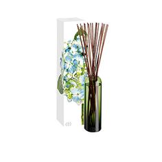 DayNa Decker Botanika Essence Indigo Diffuser - Apple, Plumeria, Muguet, Ozone, White Wood & Musk Powder. Signature botanical oils. Hand blown, green vessel. Twenty reed sticks. 16 oz.