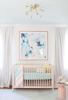 Beautiful nursery design! Love the soothing colors.