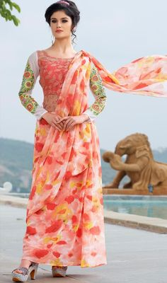 Reveal the exuberance in you donning this pink color georgette and net printed gown. The enticing block print and resham work a substantial element of this gown.  #printedgown #gowncollection #floraldesigngown2015