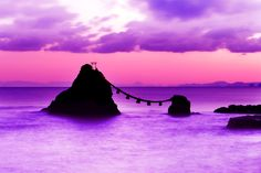 """Morning glow - The rocks are named """"Meoto Iwa"""".  It means """"Couple Rocks"""". You can see Mt.Fuji between the rocks.  The distance is about 200km."""