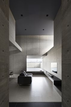 On a busy highway in Shiga, Japanese architecture firm Form/Kouichi Kimura has completed 'Tranquil House'; a reinforced concrete building that, at first glance, more resembles. Interior Minimalista, Design Minimalista, Minimalist Architecture, Minimalist Interior, Minimalist Home, Interior Design Examples, Interior Design Inspiration, Cabinet D Architecture, Interior Architecture