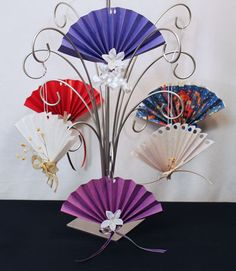 This fun and easy construction paper fan ornament can be make from different types of paper. Add ribbon to quickly make the pretty ornaments.