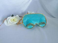 Holly Golightly - Breakfast at Tiffanys inspired sleep mask - Audrey Hepburn by HandMadeByGreenTea on Etsy https://www.etsy.com/listing/254110822/holly-golightly-breakfast-at-tiffanys
