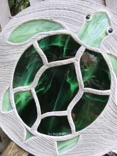 Mama sea turtle has a shell made with pretty dark green wispy stained glass and flippers, head and tail of forest green wispy opal. This is