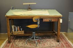 I'm not sure what I like most... the rustic desk (and I'd fix that blotter) or the fact that it's clean, tidy and EMPTY