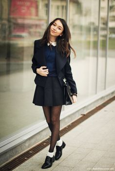 Ankle socks over tights with a pleated skirt and collared top for a school girl chic look