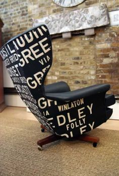 """This original 1960's """"Bloefled"""" Chair (as seen in James Bond Films) has been lovingly recovered in black faux leather and a vintage bus blind, with ottoman. Looks so comfy."""