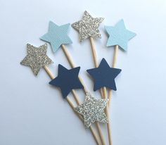 Small Star Cupcake Toppers in Light Blue, Navy, Silver Glitter.  Twinkle Twinkle Little Star.  Boy Baby Shower or Birthday.  Cupcake Decor by PaperTrailbyLauraB on Etsy https://www.etsy.com/listing/216095054/small-star-cupcake-toppers-in-light-blue