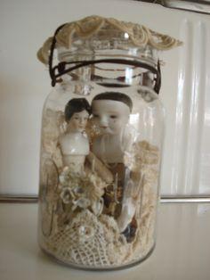 Antique dolls in a jar