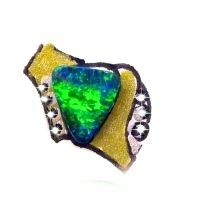 Triangular black boulder opal set in yellow gold and diamond ring. A feature for ladies fashions and jewelry (jewellery)