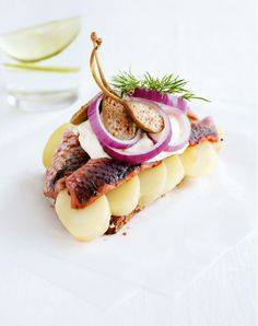 "Eat traditional Danish Lunch, smørrebrød. Rye bread and delicious toppings. Yummy.        And don't forget to download the free iPhone app ""Smørrebrød from Copenhagen"" in app store.  http://www.visitdenmark.com/smorrebrod  Photo credit: Kam & Co"