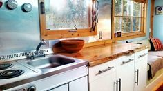 """We love the """"live edge"""" kitchen counter, made from a slab of beetle killwood, polished and stained to a glossy perfection.  #TinyHouseforUs"""