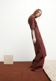 """""""On the Verge"""". T: The New York Times Style Magazine debuts SCHAI FW16 collection with in-depth story on the designer, Suk Chai. Seen Here: The Kandan Dress and Magnum Belted Trouser in Dark Rust."""