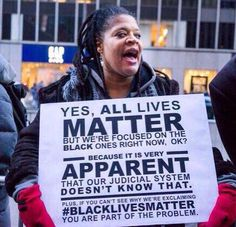 An African American woman expressing her concerns over those who try to persuade the media away from the matters at hand.