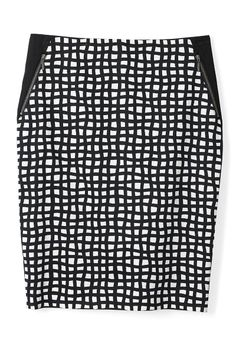 A figure-flattering windowpane-print pencil skirt features slimming black insets at the waist.