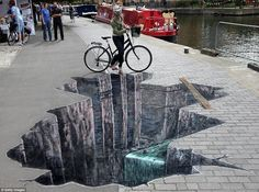 hole 3D Drawings On Paper | Don't look down now: Cyclists faced with huge 'hole' in the ground on ...