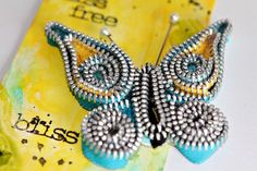 Butterfly embellishment using zipper trim