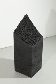 black sand and resin sculpture by Lisha Bai