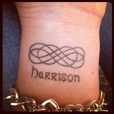 tattoos of childrens names for women | wrist name tattoo with hearts childrens names tattooed on shoulder