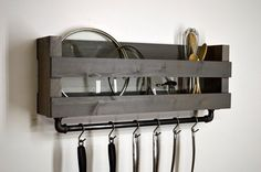 [ D E S C R I P T I O N ] Add a touch of country style to your kitchen. This pot and lid rack mounts to the wall freeing up cabinet space. A 24 cast iron bar is firmly attached to the bottom with 6 hooks to conveniently hang pots, pans, and utensils you use most. -------------------------------------------------- [ F I N I S H / C O L O R ] Weathered Gray -------------------------------------------------- [ D I M E N S I O N S ] 29 Width x 10 Height x 6 Depth Overall height including bar is…