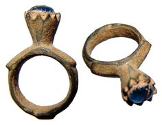 Byzantine Empire, c.10th-12th Century AD. Nice bronze ring with tall bezel fit with a beautiful blue glass 'stone'. Stone has crack but sits securely. About a US ring size 4.25, 32 mm tall. Intact with earthen encrustation. Found in the Holy Land.