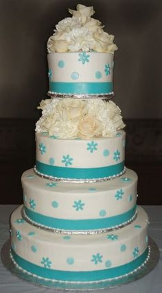 Buttercream iced with fondant ribbon, flowers and dots.