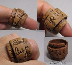 AlessiaStre on her flickr site. Got to try it Interesting idea to make polymer clay rings like this