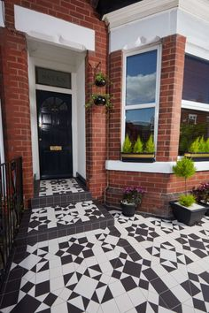 Transform the front of your home with Victorian style geometric floor tiles. An intricate pattern looks very chic in a monochrome palette of black and white.